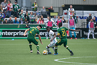 Portland, Oregon - Sunday September 22, 2019: Darwin Quintero #25 tries to get past Jorge Moreira #2 and Diego Chara #21 during a regular season game between Portland Timbers and Minnesota United at Providence Park on September 22, 2019 in Portland, Oregon.