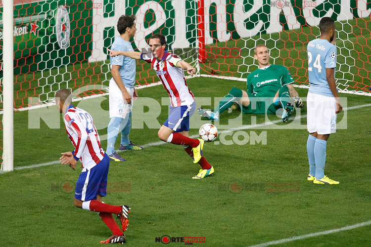 Atletico de Madrid´s Diego Godin scores a goal during Champions League soccer match between Atletico de Madrid and Malmo at Vicente Calderon stadium in Madrid, Spain. October 22, 2014. (ALTERPHOTOS/Victor Blanco)
