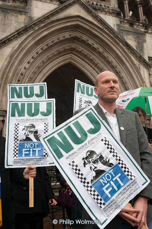 Videographer Jason N Parkinson joins a protest outside the Royal Courts of Justice, called by the NUJ London Photographers Branch on the day of a judicial review of a decision to grant a Production Order to Essex Police allowing them to seize his and others' unpublished footage of an eviction at Dale Farm Travellers site.