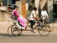 A bicycle rickshaw at work in Varanasi, Uttar Pradesh, India