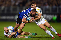 Tom Dunn of Bath Rugby is double-tackled by Matt Kvesic and Ollie Devoto of Exeter Chiefs. Gallagher Premiership match, between Bath Rugby and Exeter Chiefs on October 5, 2018 at the Recreation Ground in Bath, England. Photo by: Patrick Khachfe / Onside Images