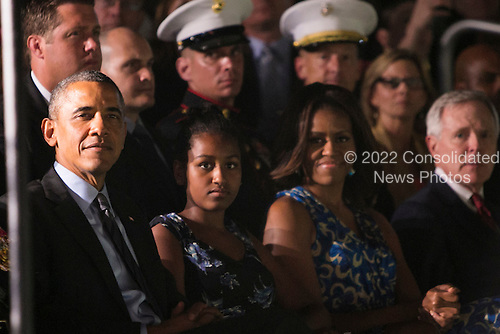 United States President Barack Obama, left, daughter Sasha Obama, center, and First Lady Michelle Obama, right, attend the Marine Barracks Washington, D.C. Evening Parade in Washington, D.C., on Friday, June 27, 2014. <br /> Credit: Kristoffer Tripplaar  / Pool via CNP