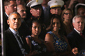 United States President Barack Obama, left, daughter Sasha Obama, center, and First Lady Michelle Obama, right, attend the Marine Barracks Washington, D.C. Evening Parade in Washington, D.C., on Friday, June 27, 2014. <br /> Credit: Kristoffer Tripplaar  / Pool via CNP