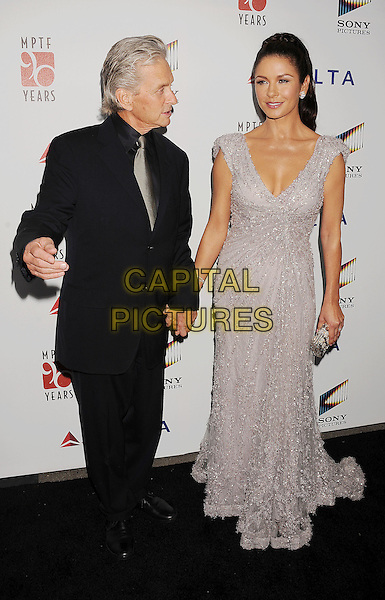 "Michael Douglas & Catherine Zeta-Jones.The 6th Annual ""A Fine Romance"" Event Held At Sony Pictures Studios, Culver City, California, USA, 15th October 2011..full length grey gray suit shirt black blue  silver beaded dress grey gray purple lilac maxi clutch bag holding hands married husband wife profile .CAP/ROT/TM.©Tony Michaels/Roth Stock/Capital Pictures"