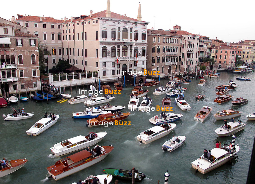 Paparazzis on the boats  - GEORGE CLOONEY &amp; AMAL ALAMUDDIN WEDDING CEREMONY AT THE AMAN RESORTS HOTEL IN VENICE - <br /> George Clooney &amp; British fiancee Amal Alamuddin and guests on taxi boat on the Grand Canal on their way to the seven-star Aman Hotel for the wedding celebrations.<br /> Robert De Niro, Matt Damon, Brad Pitt and Cate Blanchett were among the other stars, like Cindy Crawford, Rande Geber, Bill Murray, Emily Blunt.<br /> Italy, Venice, 27 September, 2014.