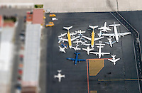 Toluca, Mexico March 3, 2007. An aerial photograph of a  pattern of closely parked planes at the Toluca airport.