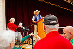 Larry Vroom, a Sun City resident since 2004, handles a raffle inside of the the annual Arts and Crafts Festival where 37 Sun City clubs sold their wares to more than 16,000 shoppers over three days in Sun City, Arizona in late November 2013.