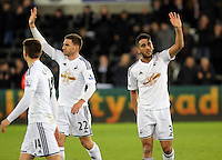 Pictured L-R: Angel Rangel and Neil Taylor of Swansea thank supporters after the end of the game Saturday 10 January 2015<br />