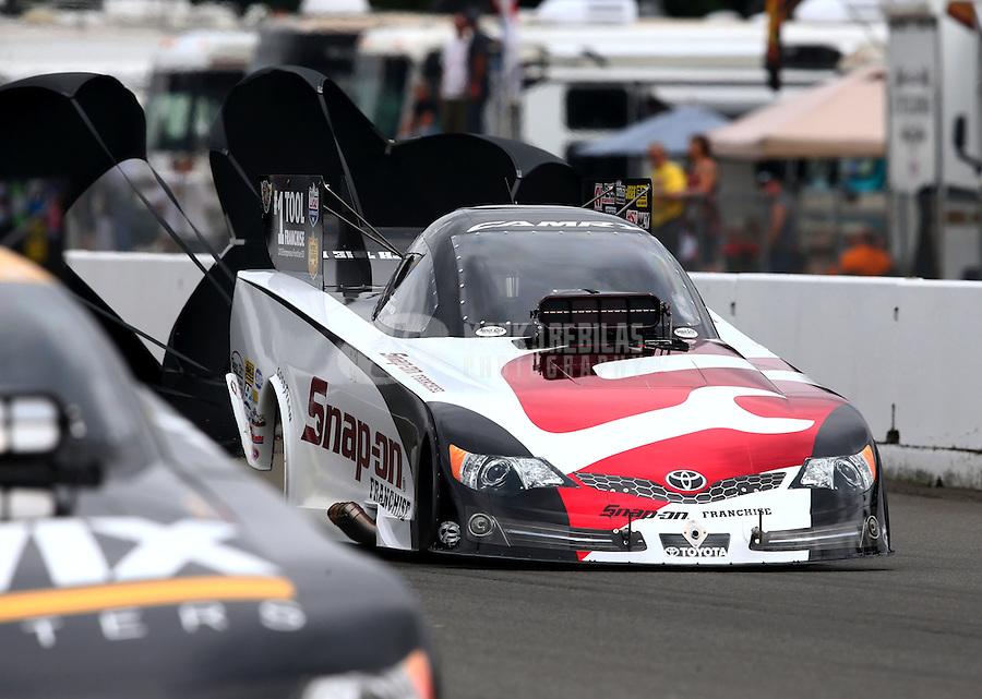 Aug. 3, 2013; Kent, WA, USA: NHRA funny car driver Cruz Pedregon during qualifying for the Northwest Nationals at Pacific Raceways. Mandatory Credit: Mark J. Rebilas-USA TODAY Sports