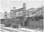 A view of the D&amp;RGW Salida barrel transfer dumping the load of a narrow-gauge gondola into a hidden-from-view standard gauge car.<br /> D&amp;RGW  Salida, CO  Taken by Richardson, Robert W. - 1956