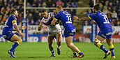 23rd March 2018, Halliwell Jones Stadium, Warrington, England; Betfred Super League rugby, Warrington Wolves versus Wakefield Trinity; Tinirau Arona tackled by Jack Hughes