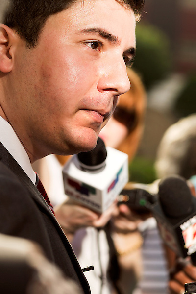 "July 13, 2015. Winston Salem, North Carolina.<br />  Ricky Diaz, the spokesperson for the North Carolina Republican Party, was questioned by the press after he announced the initiation of the party's ""Immoral Mondays"" website. The site claims to expose the out of state funding of the Moral Monday events that have been popular with democratic voters over the last few years. <br />  A press conference was held outside the federal courthouse on the opening day of the North Carolina NAACP's case against Gov. Pat McCrory ( NC NAACP v. McCrory)<br />  The NC NAACP contests that HB 589 (Voter ID requirements) violate Section 2 of the Voting Rights Act (42 U.S.C. 1973) and the Fourteenth and Fifteenth Amendments of the Constitution."