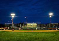 Little League baseball game at night.