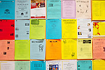A bulletin board in the Bell Auditorium shows club announcements. There are more than 120 clubs--from ceramics to orchestra to cheerleading-- to keep the residents very busy.