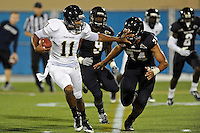 30 March 2012:  FIU's Akil Dan-Fodio (11) attempts to hold off Lars Koht (74) while carrying the ball at the FIU Football Spring Game at University Park Stadium in Miami, Florida.