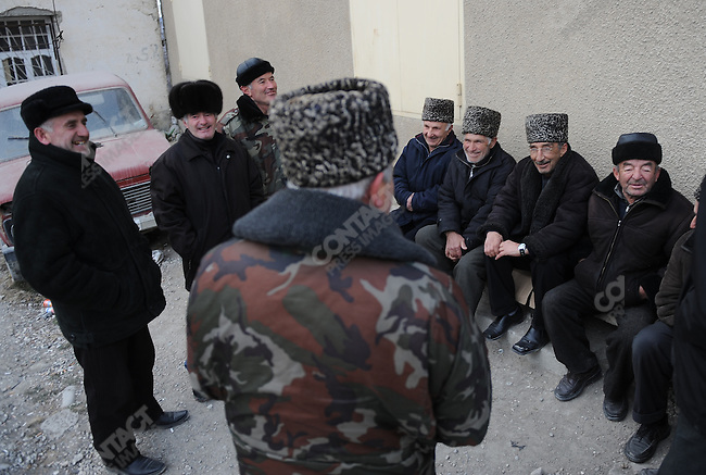 In the village of Hadji-Makhi in the mountains west of of the Dagestani capital Mahachkala men gathered to chat at the end of the day.  Dagestanis are reknowned as great joke tellers, often of jokes based on characters from the multi-ethnic web of the republic. January 26, 2010