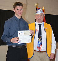 Janelle Jessen/Herald-Leader<br /> Frank Lee, commander of Veterans of Foreign Wars Post 1674, right, presented Adam Kennedy with the first place award and a $100 prize for the Voice of Democracy speech contest on Feb. 12. This year's speech topic was &quot;Why My Vote Matters.&quot; The second place winner, Katherine Arrington, was not present.