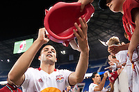 Tyler Ruthven (15) of the New York Red Bulls signs autographs after the match. The New York Red Bulls defeated the Houston Dynamo 1-0 during a Major League Soccer (MLS) match at Red Bull Arena in Harrison, NJ, on May 09, 2012.