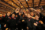 12 MAR 2011:  Members of the University of Nebraska-Omaha wrestling team accept their championship trophy during the Division II Men's Wrestling Championship held at the UNK Health and Sports Center on the University of Nebraska - Kearney campus in Kearney, NE. Corbey R. Dorsey/ NCAA Photos