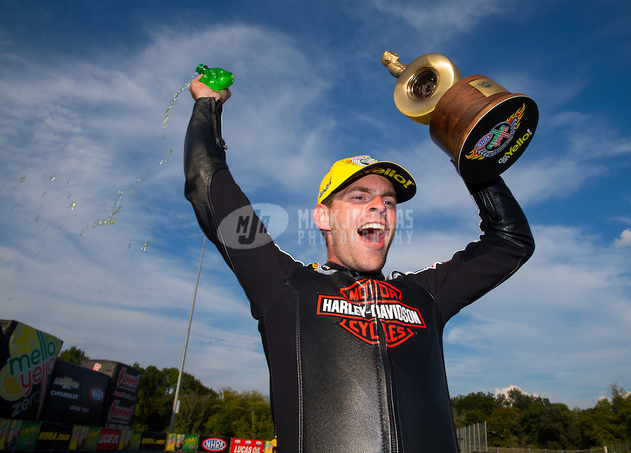 Sep 20, 2015; Concord, NC, USA; NHRA pro stock motorcycle rider Andrew Hines celebrates after winning the Carolina Nationals at zMax Dragway. Mandatory Credit: Mark J. Rebilas-USA TODAY Sports