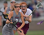 Belleville's Hailey Chouinard (left) is pressured by Lockport's Abigail Connelly behind the Lockport net. Belleville played Lockport in a quarterfinal game of the O'Fallon sectional at O'Fallon Sports Park on Monday May 20, 2019. <br /> Tim Vizer/Special to STLhighschoolsports.com