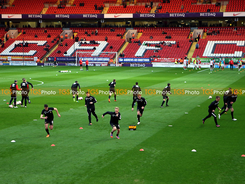 MK Dons players warm up pre-match during Charlton Athletic vs MK Dons, Sky Bet EFL League 1 Football at The Valley on 4th April 2017