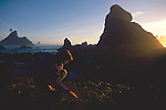 Woman beachcombing, Shi Shi Beach, Olympic National Park, Sea stacks, Point of the Arches, Washington State, Pacific Northwest, Pacific Ocean, USA, Point of Arches was originally purchased for preservation by The Nature Conservancy, Sarah Shannon,