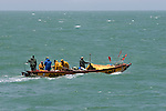 Pirogue off Senegal. The livelhihoods of these fishermen is under threat from unlicensed, unregulated ships from China and elsewhere, while the fish are shipped to the Supermarkets of Europe.