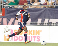 New England Revolution midfielder Clyde Simms (19) brings the ball forward. In a Major League Soccer (MLS) match, Toronto FC defeated New England Revolution, 1-0, at Gillette Stadium on July 14, 2012.