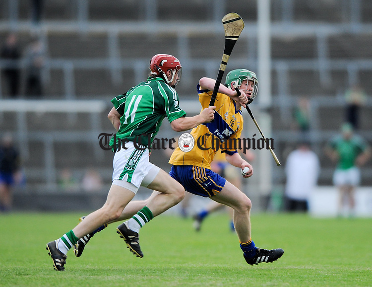 Thomas Ryan of Limerick in action against Jamie Shanahan of Clare during their Munster minor championship semi-final at The Gaelic Grounds. Photograph by John Kelly.
