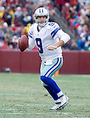 Dallas Cowboys quarterback Tony Romo (9) looks to pass in second quarter action against the Washington Redskins at FedEx Field in Landover, Maryland on Sunday, December 28, 2014.  <br /> Credit: Ron Sachs / CNP