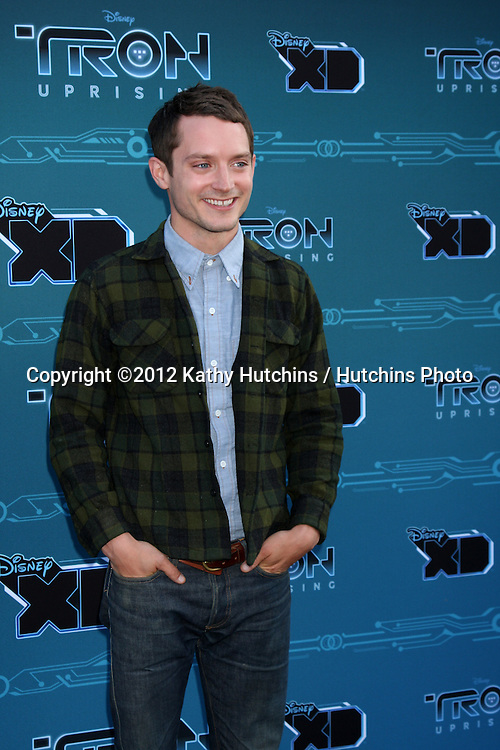 "LOS ANGELES - MAY 12:  Elijah Wood arrives at the Disney XD's ""TRON: Uprising"" Press Event and Reception at DisneyToon Studios/Disney Television Animation on May 12, 2012 in Glendale, CA"