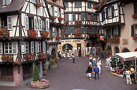 AJ2132, Alsace, France, Europe, Colmar, Haut Rhin, People shopping in the city of Colmar, capital of Haut Rhin, with its half-timbered houses (Alsatian-style buildings) with flowers in window boxes that line the narrow streets in downtown.