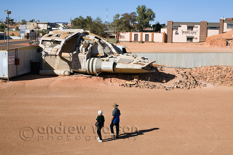 Tourists inspect a movie prop spaceship from the film Pitch Black left in the township of Coober Pedy, South Australia, AUSTRALIA.