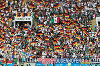MOSCOW, RUSSIA - June 17, 2018: Germany fans wave flags before the Germany vs. Mexico 2018 FIFA World Cup group stage match at Luzhniki Stadium.
