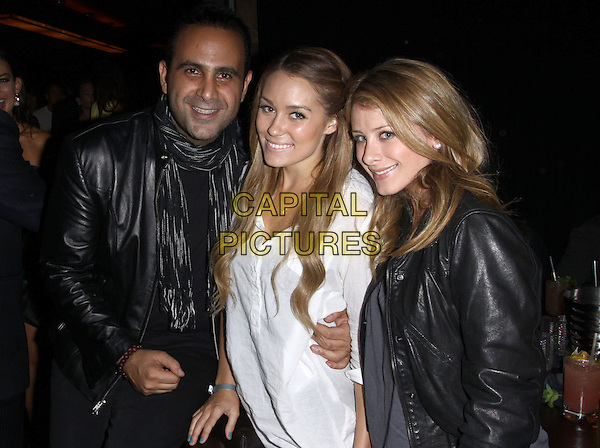 "SAM NAZARIAN, LAUREN CONRAD & LAUREN ""LO"" BOSWORTH.SBE's Hyde Lounge Grand Opening At The Staples Center - Inside held At Hyde Lounge, Los Angeles, California, USA,.November 6th 2009..half length white shirt leather black jacket smiling .CAP/ADM/KB.©Kevan Brooks/AdMedia/Capital Pictures."