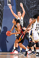 25 November 2011:  FIU guard Fanni Hutlassa (10) attempts to block a shot by Maryland center Alicia DeVaughn (13) in the second half as the University of Maryland Terrapins defeated the FIU Golden Panthers, 84-52, at the U.S. Century Bank Arena in Miami, Florida.
