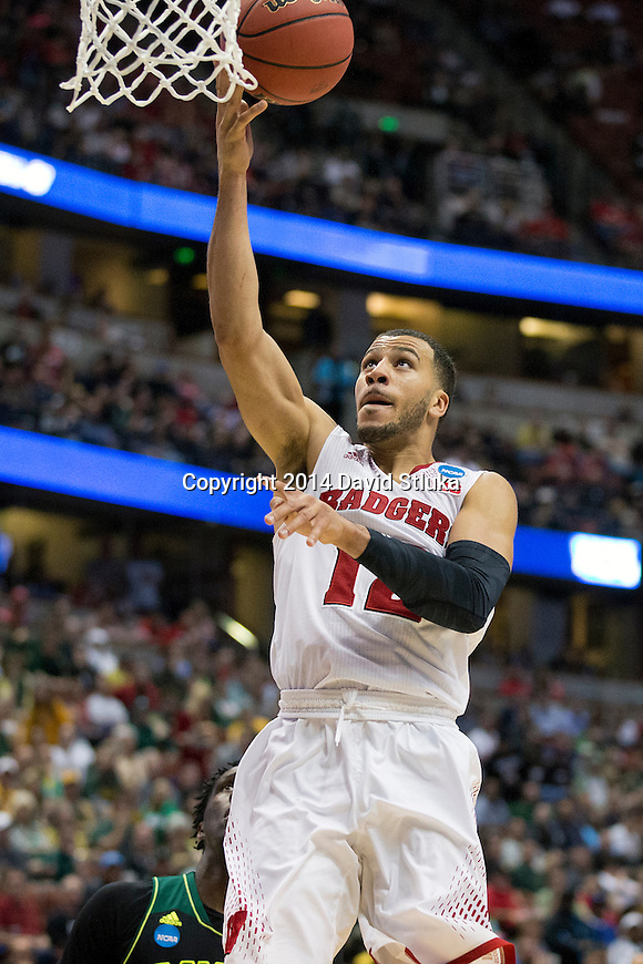 Wisconsin Badgers guard Traevon Jackson (12) shoots a layup during  a regional semifinal NCAA college basketball tournament game against the Baylor Bears Thursday, March 27, 2014 in Anaheim, California. The Badgers won 69-52. (Photo by David Stluka)