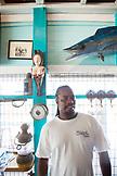 EXUMA, Bahamas. A local man inside the Staniel Cay Yacht Club in Staniel Cay.