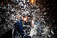 Belinda Silva, of San Francisco, dodges an incoming pillow amidst a cloud of feathers at the third annual Great San Francisco Pillowfight On Valentine's day Thursday evening, Feb. 14, 2008 in Justin Herman Plaza.