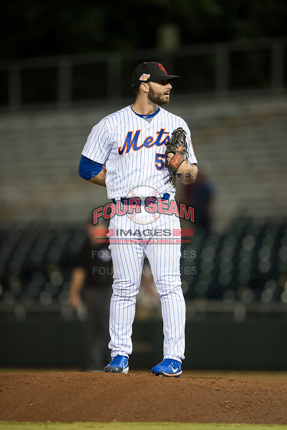 Scottsdale Scorpions relief pitcher Joe Zanghi (54), of the New York Mets organization, looks in for the sign during an Arizona Fall League game against the Mesa Solar Sox on October 9, 2018 at Scottsdale Stadium in Scottsdale, Arizona. The Solar Sox defeated the Scorpions 4-3. (Zachary Lucy/Four Seam Images)