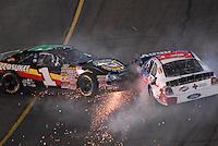 Apr 20, 2007; Avondale, AZ, USA; Nascar Busch Series drivers J.J. Yeley (1) and Jon Wood (47) crash during the Bashas Supermarkets 200 at Phoenix International Raceway. Mandatory Credit: Mark J. Rebilas