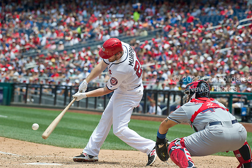 Washington Nationals second baseman Daniel Murphy (20) connects for a two R.B.I. single in the sixth inning against the New York Mets at Nationals Park in Washington, D.C. on Tuesday, July 4, 2017.  The Nationals won the game 11 - 4.<br /> Credit: Ron Sachs / CNP<br /> (RESTRICTION: NO New York or New Jersey Newspapers or newspapers within a 75 mile radius of New York City)