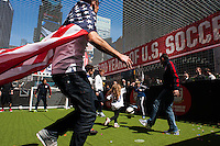 Former men's national team players Cobi Jones, Jimmy Conrad, Alexi Lalas, and Tab Ramos play a small sided game with fans during the centennial celebration of U. S. Soccer at Times Square in New York, NY, on April 04, 2013.