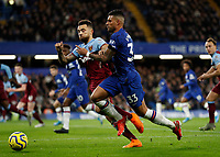 30th November 2019; Stamford Bridge, London, England; English Premier League Football, Chelsea versus West Ham United; Emerson Palmieri of Chelsea is challenged by Ryan Fredericks of West Ham United  - Strictly Editorial Use Only. No use with unauthorized audio, video, data, fixture lists, club/league logos or 'live' services. Online in-match use limited to 120 images, no video emulation. No use in betting, games or single club/league/player publications