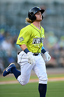 Seconed baseman Nick Conti (21) of the Columbia Fireflies runs out a batted ball in a game against the Hickory Crawdads on Wednesday, August 28, 2019, at Segra Park in Columbia, South Carolina. Hickory won, 7-0. (Tom Priddy/Four Seam Images)