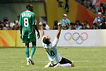 23 August 2008: Javier Mascherano (ARG) (14) celebrates at the final whistle, as Sani Kaita (NGA) (8) walks away. Argentina's Men's National Team defeated Nigeria's Men's National Team 1-0 at the National Stadium in Beijing, China in the Gold Medal match in the Men's Olympic Football tournament.