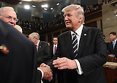 US President Donald J. Trump shakes hands on his way out after delivering his first address to a joint session of Congress from the floor of the House of Representatives in Washington, DC, USA, 28 February 2017.  Traditionally the first address to a joint session of Congress by a newly-elected president is not referred to as a State of the Union.<br /> Credit: Jim LoScalzo / Pool via CNP