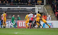 Medy Elito of Cambridge United (far right) scores his side's opening goal during the Sky Bet League 2 match between Cheltenham Town and Cambridge United at the LCI Stadium, Cheltenham, England on 18 March 2017. Photo by Mark  Hawkins / PRiME Media Images.