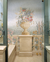 Custom bath wall featuring flower mosaics in polished and honed marble